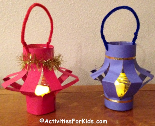 A glittery Chinese Paper Lantern craft for kids to make from ActivitiesForKids.com #chinesenewyear How cute - add a battery operated candle for paper lanterns that light up! Chinese New Year Crafts for Kids.
