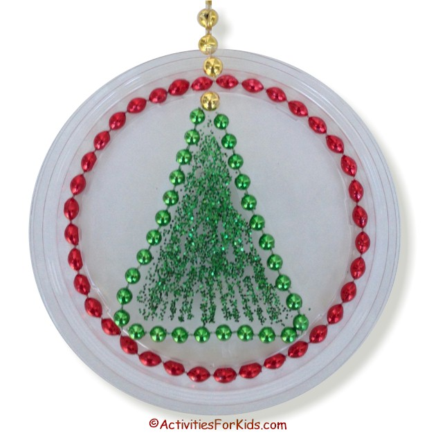 Christmas Tree decoration using red and green Mardi Gras Beads.  Use a clear lid to create a Christmas Tree Sun Catcher.  #Christmascrafts
