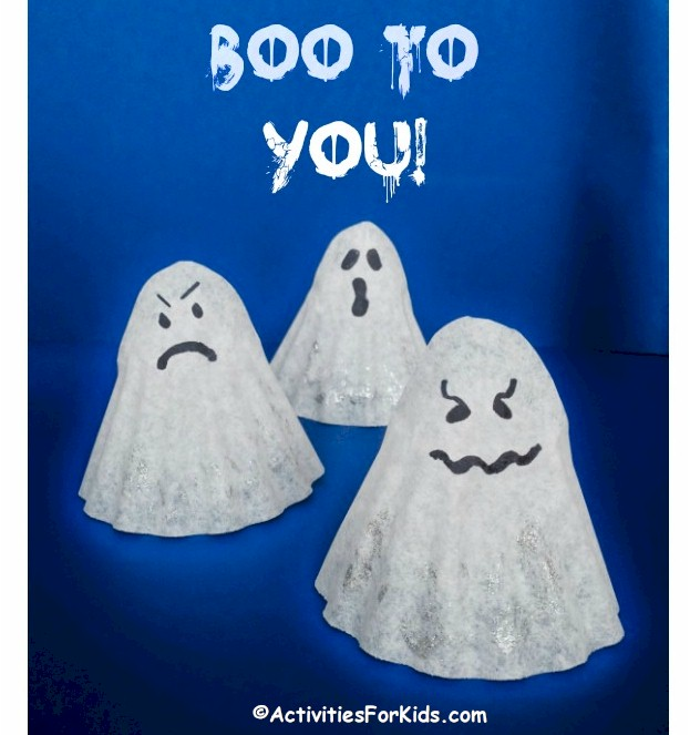 Easy Halloween Crafts for kids - Coffee filter ghost.  Make one.  Decorate and use as decorations for Halloween.  Printable for Witches Hats can be found at ActivitiesForKids.com