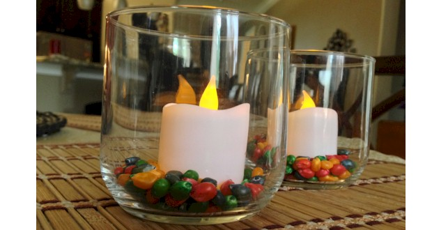 A colorful Thanksgiving table decoration with dyed popcorn kernels at ActivitiesForKids.com