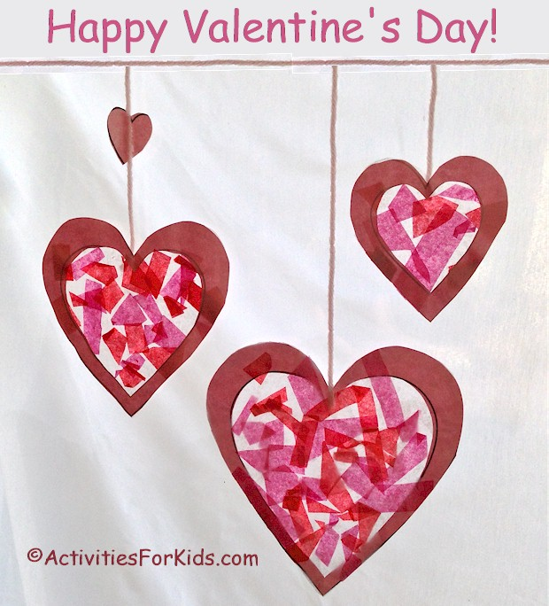 Hearts stained glass suncatcher for Valentine's Day.  Printable heart template at ActivitiesForKids.com