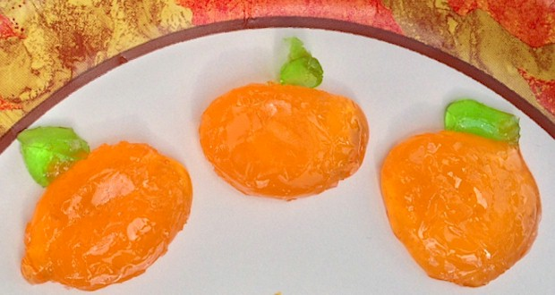 Hard candy makes cute little pumpkins to use for decorating cakes and cupcakes from ActivitiesForKids.com