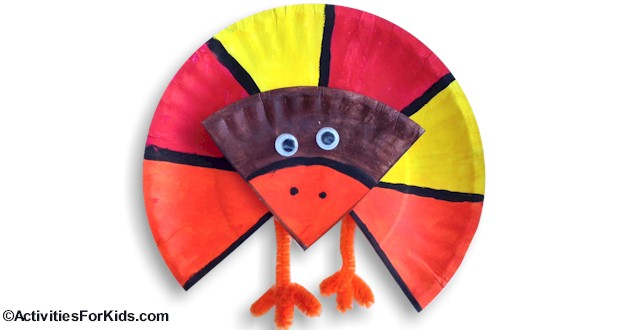 Easy #Thanksgiving Crafts for kids.  Colorful Turkey decoration for Thanksgiving - use this holiday craft to learn about fractions. Instructions at ActivitiesForKids.com