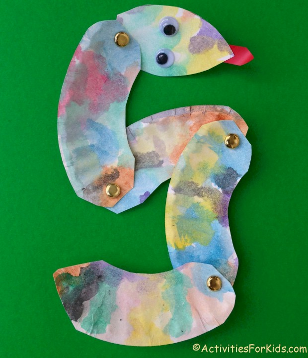 Easy and inexpensive to make, paper plate snake craft for kids.  Cut apart in sections for a bendable snake.  Kids crafts for St. Patrick's Day, Chinese New Year or Bible Study of Adam and Eve.  ActivitiesForKids.com