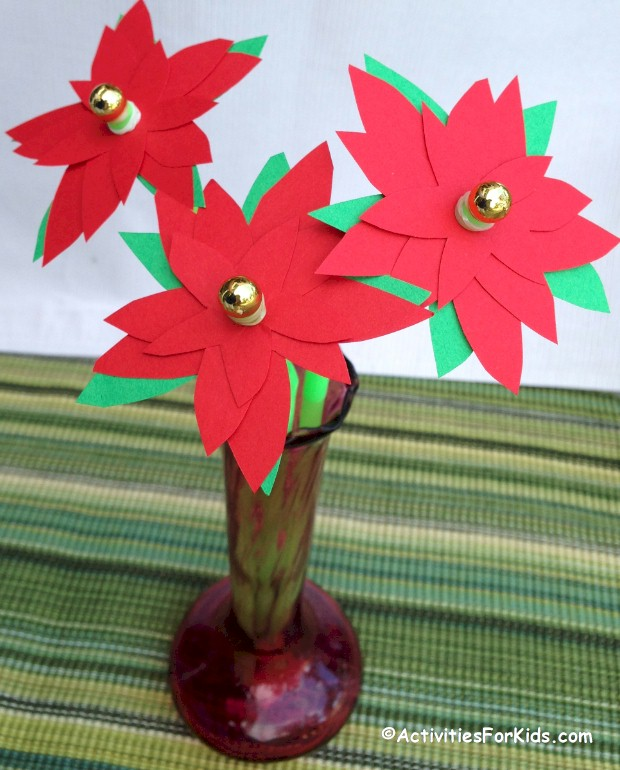 Poinsettia Crafts for Kids with a printable poinsettia flower pattern.  Easy holiday crafts for kids, pretty paper poinsettia craft from Activities for Kids.  #Christmascrafts