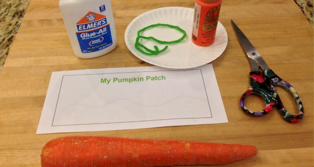 Use a sliced carrot as a stamp for pumpkins.  Family Pumpkin Patch craft for kids.