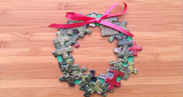Puzzle Piece Wreath, holiday decoration for kids to make at ActivitiesForKids.com