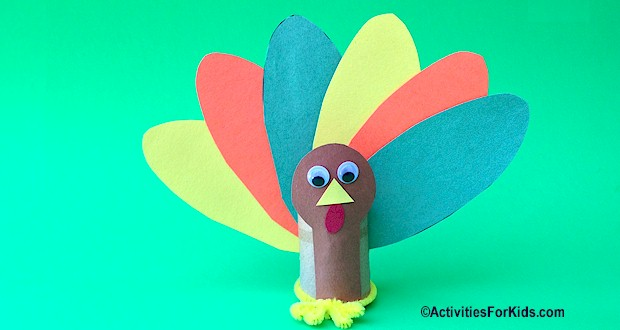 Colorful Turkey for Thanksgiving.  Instructions and printables for the TP roll Turkey Craft at ActivitiesForKids.com