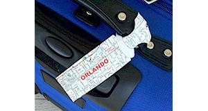 Luggage tag for kids to make for their next vacation at ActivitiesForKids.com.  Use an old map to create this luggage tag.