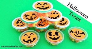 Cheap party favor!  Individual candy containers using a printable pumpkin face template.  ActivitiesForKids.com