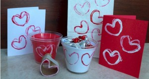 Decorate for Valentine's Day with toilet paper roll heart stamps.