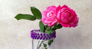 Mini Beaded Vase using a recycled jar and Mardi Gras beads.