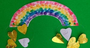 Rainbow with gold treasure hearts
